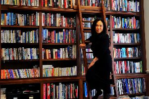 One of the reception rooms has been tarnsformed into a library/study. Makiko is pictured on the library ladder.