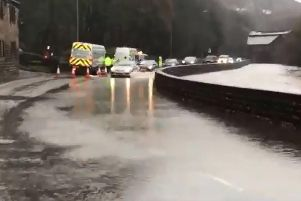 The A646 in Todmorden has been flooded by the River Calder.