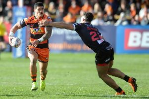 Man of the match Pete  Mata'utia evades Darrell Olpherts. PIC: Tony Johnson
