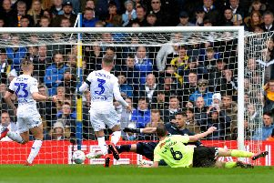 Sheffield United's Chris Basham hits the deck after sliding in the only goal of the game for the visitors against Leeds United (Picture: Bruce Rollinson).