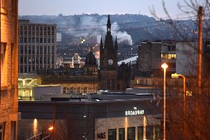 The gothic Victorian spire of the Wool Exchange dominates the Bradford city centre skyline