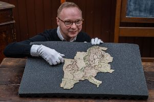 Phillip Newton, Communities Engagement Researcher at York Castle Museum with the rare 18th Century jigsaw map of Europe.