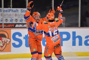 Jonathan Phillips celebrates his goal against Cardiff Devils last Saturday with line-mate Anthony DeLuca - who scored the other four. Picture: Dean Woolley.