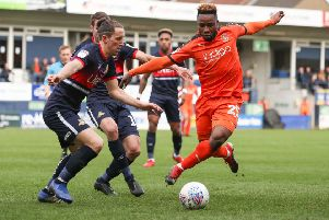My ball: Luton Town's Kazenga LuaLua is challenged by Doncaster Rovers' Aaron Lewis.