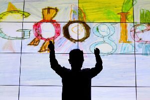 Darragh Brady from Edmondstown National School in Dublin in front of his doodle on stage at Google offices in Dublin after he won the Junior category  in the 'Doodle for Google' competition. PRESS ASSOCIATION Photo. Picture date: Monday March 12, 2012. See PA story TECHNOLOGY Google Ireland. Photo credit should read: Julien Behal/PA Wire