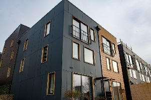 The houses are inspired by Scandinavian design and are timber-framed with composite cladding.