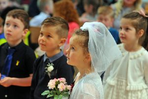 Nursery and reception pupils from Drighlington Primary School take part in a mock wedding at St Paul's Church, with Bride Kelissi Lister-Kemp and groom Blake Green taking the staring roles. Picture Tony Johnson.