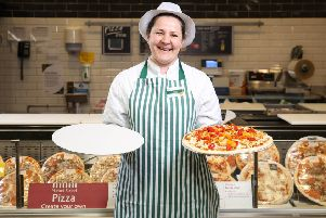Customer assistant Emilia Sliwinska displays a new cardboard tray for pizzas, as Morrisons announces that it will be completely removing polystyrene from all own-brand food and drink products nationwide, at Morrisons Colindale in London.  Photo: Matt Alexander/PA Wire