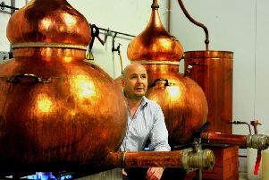 280219   Karl Mason Director and co-founder  of Masons Gin inbetween two of the Stills  at their plant in Bedale.