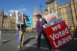 Protestors both for and against Brexit face off outside Westminster in London. Picture: Jonathan Brady/PA Wire