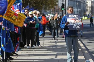 Anti-Brexit protestors line the streets outside Westminster in London. Pic: Jonathan Brady/PA Wire