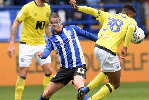 Back in action: Owls striker Sam Winnall against Blackburn Rovers.