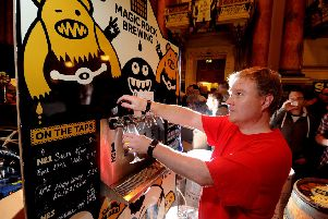 Date:6th September 2014, picture James Hardisty, (JH1005/04a) Leeds International Beer Festival held at Leeds Town Hall. Pictured Mike Wallis, pulling a pint of Salty Kiss on the Magic Rock stand.