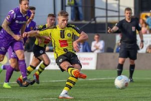 Harrogate Town's Jack Muldoon converts from the penalty spot during Saturday's National League encounter with Maidstone United. Picture: Matt Kirkham