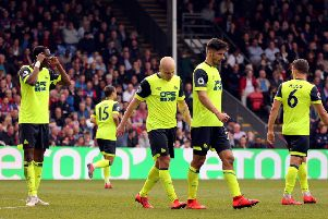 Going down: Huddersfield Town players show dejection.