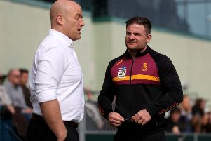 Huddersfield Giants coach Simon Woolford, right, talks with London Broncos' coach Danny Ward.