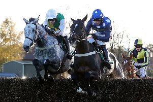 Vintage Clouds and Danny Cook (left) are guaranteed a place in the Grand National line-up this weekend.