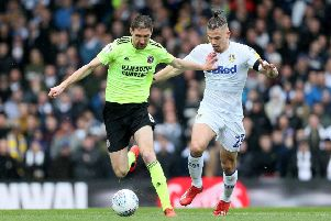 Sheffield United's Chris Basham, left, and Leeds United's Kalvin Phillips battle for the ball during last month's Championship match. The Blades and Whites are leading Yorkshire clubs' chase for automatic promotion but at least one may end up in the Wembley play-off final (Picture: Richard Sellers/PA Wire).