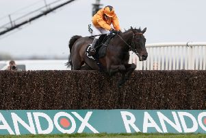 Tea For Two and Lizzie Kelly - pictured winning the 2017 Betway Bowl - are due to line up in the Grand National this weekend.