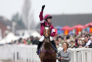 Jockey Bryan Cooper celebrates victory on Don Poli following the RSA Chase at Cheltenham in 2015