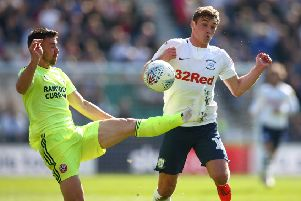 Sheffield United's Enda Stevens and Preston North End's Ryan Ledson (right) battle for the ball (Picture: PA)