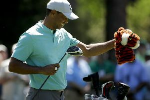 Feeling relaxed: Four-time winner Tiger Woods during a practice round ahead of the Masters. (AP Photo/Charlie Riedel)