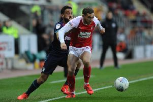 Rotherham United's Jon Taylor gets the better of Aston Villa's Neil Taylor. Picture: Tony Johnson.