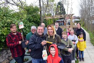 Former Blue Peter gardener Chris Collins and founder Jennie Franks (middle) with the volunteers.