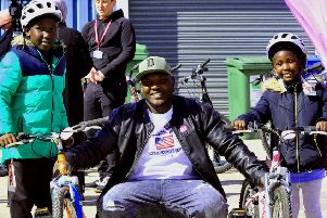 Waleed Bashir with his children Waghe 10 (left) and Wjhen  Bashir  with their new bicycles at R-evoution in Cottingham near Hull part of a new scheme for refugees to get bicycles..
