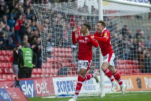 Game over: Jacob Brown celebrates with Callum Styles after scoring the fourth goal.