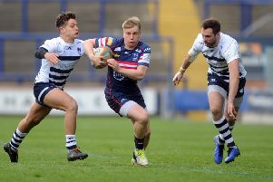 Doncaster Knights' Cameron Cowell runs between Carnegie's Sam Wolstenholme and Andrew Forsyth. (Picture: Tony Johnson)
