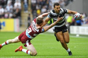 Hull FC's Carlos Tuimavave is tackled by Wigan Warriors' Dan Sarginson