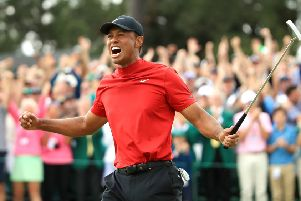 Tiger Woods of the United States celebrates after sinking his putt to win during the final round of the Masters at Augusta National Golf Club on April 14, 2019 in Augusta, Georgia. (Picture: Andrew Redington/Getty Images)