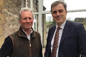 Skipton and Ripon MP Julian Smith (right) held talks over the proposed closure of Clapham C of E Primary School with Philip Farrer (left), resident trustee of the Ingleborough Estate. Picture courtesy of Clapham Community Action Group.