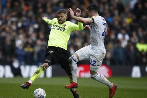 Sheffield United's Martin Cranie battles with Leeds United's Jack Harrison oduring the recent meeting at Elland Road. Picture: Simon Bellis/Sportimage