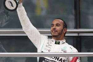 Mercedes driver Lewis Hamilton of Britain raises his trophy to fans after winning the Chinese Grand Prix. Picture: AP/Ng Han Guan