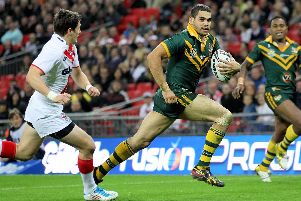Australia's Greg Inglis evades England's Gareth Widdop in the 2011 Four Nations at Wembley (SWPix)