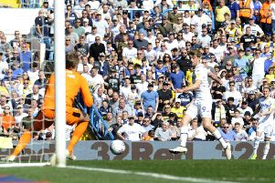 TAKE THAT: Patrick Bamford scores the opening goal for Leeds United. Picture: Simon Hulme
