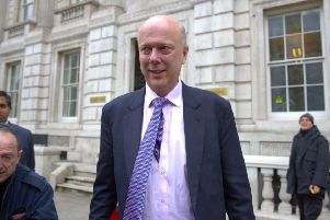 Transport Secretary Chris Grayling is micro-managing policy on road signs.