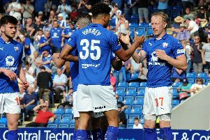 Scott Boden is congratulated by his team mates after tucking away the Spireites penalty.
