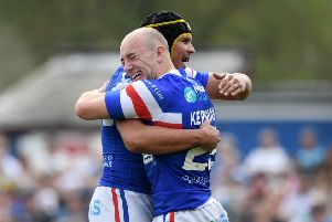 Lee Kershaw is hugged by Wakefield Trinity team-mate Ben Jones-Bishop after scoring against Leeds Rhinos (Picture: Jonathan Gawthorpe).