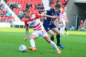Doncaster Rovers' James Coppinger: Set to return.