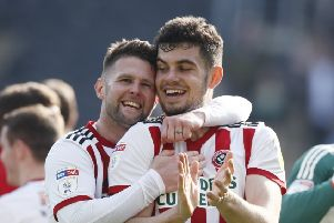 Sheffield United's Oliver Norwood and John Egan celebrate their Easter weekend win at Hull City. Picture: Simon Bellis/Sportimage