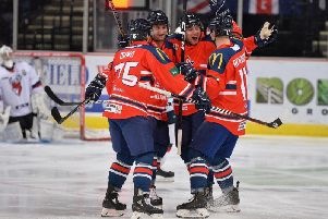GB's players celebrate Mark Richardson's first-minute opener against Topredo at Sheffield Arena. Picture: Dean Woolley.