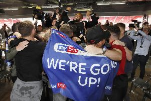 Sheffield United players dominate after their promotion is sealed.