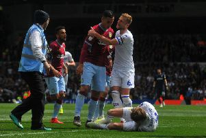 Patrick Bamford lies on the ground as Liam Cooper restrains Anwar El Ghazi during Sunday's fiery clash between Leeds United and Aston Villa.