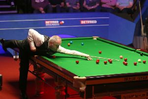 John Higgins during day fourteen of the 2019 Betfred World Championship at The Crucible, Sheffield.