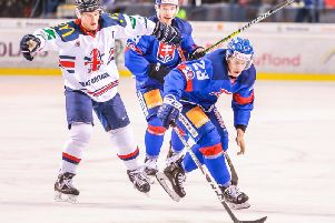TOUGH TEST: Jonathan Phillips, left, in action against Slovakia in Poprad on Saturday afternoon. Picture: Andrej Galica.
