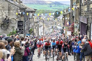 Team INEOS lead the peloton including leader Chris Lawless as they climb a hill in Haworth, during stage four of the Tour de Yorkshire. PRESS ASSOCIATION Photo. Picture date: Sunday May 5, 2019.  See PA story CYCLING Tour de Yorkshire. Photo credit should read: Martin Rickett/PA Wire