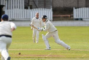 Wrenthorpe opener Irfan Amjad hits through the covers on his way to an unbeaten 68 which aw his team beat Cleckheaton on Saturday. Picture: Steve Riding.